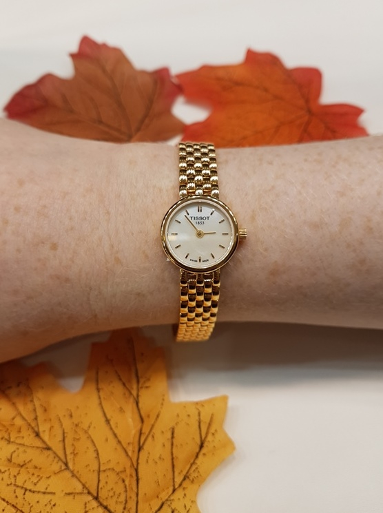 Tissot watch with autumn leaves