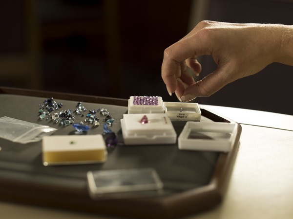 hand selecting gemstones