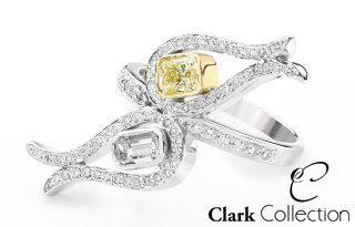 A white emerald cut diamond, set alongside a fancy intense yellow diamond. Crafted in Platinum.