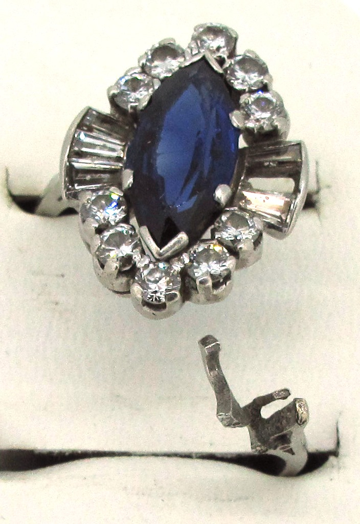 broken sapphire and diamond ring
