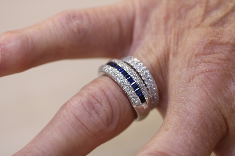 sapphire and diamond ring on customers hand